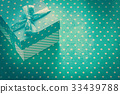 Present box with ribbon on blue polka-dot 33439788