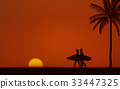 Silhouette couple surfer carrying surfboard 33447325