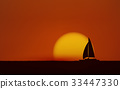 Silhouette sailboat in sea with sunset sky 33447330