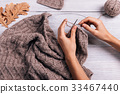 Female hand knit wool sweater, top view 33467440