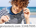 Portrait of laughing pretty girl with curly hair 33467695