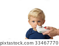 Mom using baby electric nasal aspirator 33467770