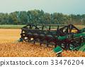 Photo of combine harvester that is harvesting crop 33476204