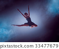 Beautiful young ballet dancer jumping on a lilac 33477679