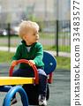 One year old baby boy toddler wearing sweater  33483577