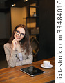Portrait young girl drinking tea and using laptop 33484010