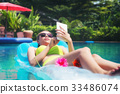 Beautiful girl relaxing in the pool  her vacation. 33486074
