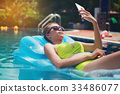 Beautiful girl relaxing in the pool  her vacation. 33486077
