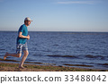 Jogging on a beach 33488042