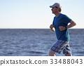 Jogging on a beach 33488043