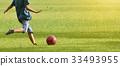 Asian boy lift foot prepare to kick soccer 33493955