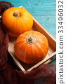 Blue, wooden table with pumpkin 33496032