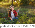 Happy woman gardener with bell pepper 33500270