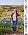 woman gardener with spade 33500272