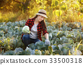 Happy woman gardener with cabbage 33500318