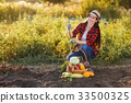 woman with basket of vegetables 33500325