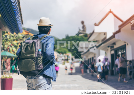 Young man traveler is visiting Tian Tan Buddha  33501925