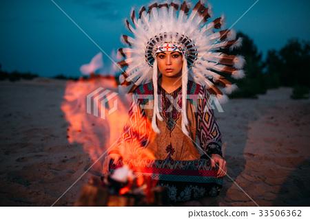 American Indian girl against bonfire, shaman 33506362