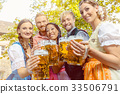 Friends in beer garden with beer glasses 33506791