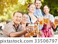 In Beer garden - friends drinking beer in Bavaria 33506797
