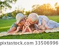 Grandparents kissing happy granddaughter. 33506996