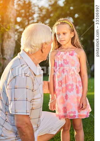Girl with grandfather outdoors. 33506997