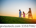 Girl with grandparents at sunset. 33507082