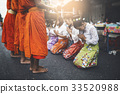Thai woman pay homage to a Buddhist monk 33520988