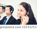 Beautiful smiling woman working in call center 33533253