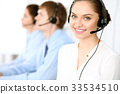 Call center operators. Focus at  business woman i 33534510