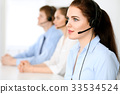 Call center operators. Focus at  business woman i 33534524
