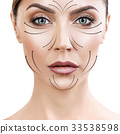 Beautiful woman face with massaging arrows on face 33538598