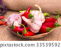 garlic, green and red hot chili peppers 33539592