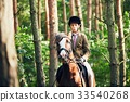 Girl riding a horse in forest 33540268