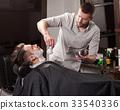 Hipster client visiting barber shop 33540336