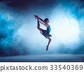 Beautiful young ballet dancer jumping on a lilac 33540369