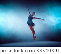 Beautiful young ballet dancer jumping on a lilac 33540391