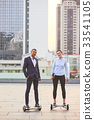 Business couple on urban background. 33541105