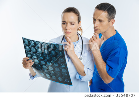Pensive medical professionals thinking over mri 33548707