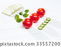 The fresh tomatos on white background 33557200