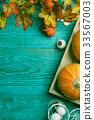 Blue surface with halloween pumpkin 33567003