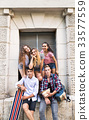 Attractive teenage students posing in front of 33577559