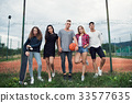 Attractive teenagers at the playground with 33577635