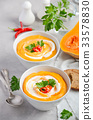 Pumpkin soup with cream and parsley  33578830