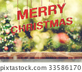 Merry Christmas red wood over wood table 33586170