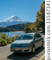 Car driving near Mt Fuji in Japan with motion blur 33587341