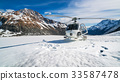 Helicopter Landing on a Snow Mountain 33587478