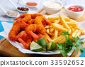 Fried Shrimps, lime wedges, french fries 33592652