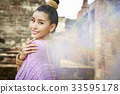 A picture of a Thai beautiful woman posing with a smile 33595178