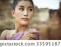 The portrait of Thai girl looking at something 33595187